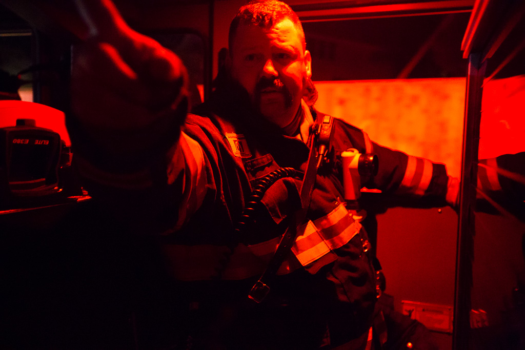 Brandon Shepard prepares himself to fight a major house fire.