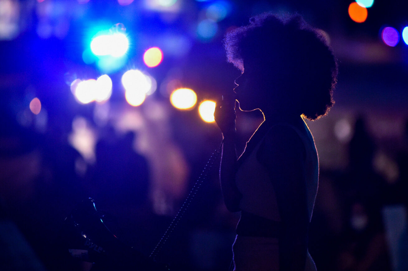 A protester speaks to other protesters near the intersection of Loop 288 and Colorado Boulevard, Saturday, June 6, 2020, in Denton, Texas.  In their seventh consecutive night of protests, local activists with Black Lives Matters met at the Square at dusk and marched to Loop 288, where they sat down and blocked traffic for around 40 minutes.