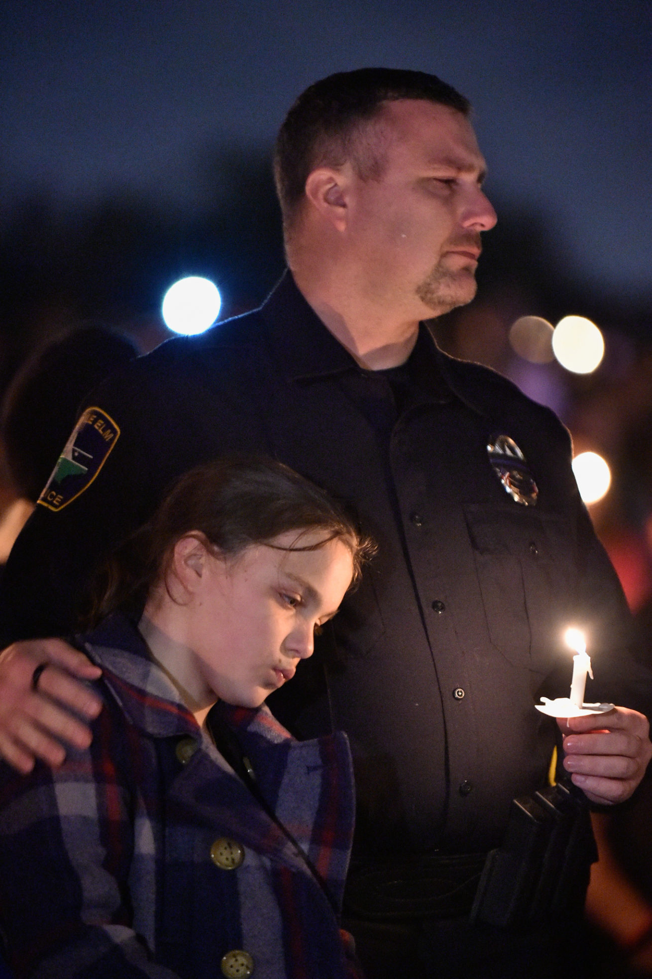 Hundreds gather to mourn, such as this Little Elm, police officer, at a vigil for Little Elm police detective, Jerry Walker, at Little Elm Park.