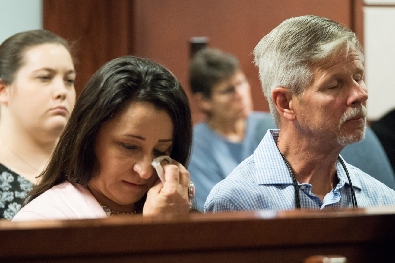 Gloria, left, and Clay Mutschlechner, parents of Sara Mutschlechner, listen to a taped interview between defendant, Eric Johnson and Naval Criminal Investigative Service agent, Jeff Ruby, at the Denton County Courthouse.