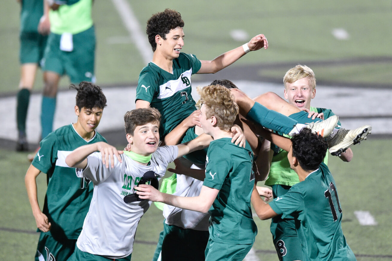 Lake Dallas' Anthony Patti (7) is hoisted by his teammates after he scores the game-winning goal against Saginaw at Lake Dallas High School, Thursday, March 28, 2019, in Corinth, Texas.