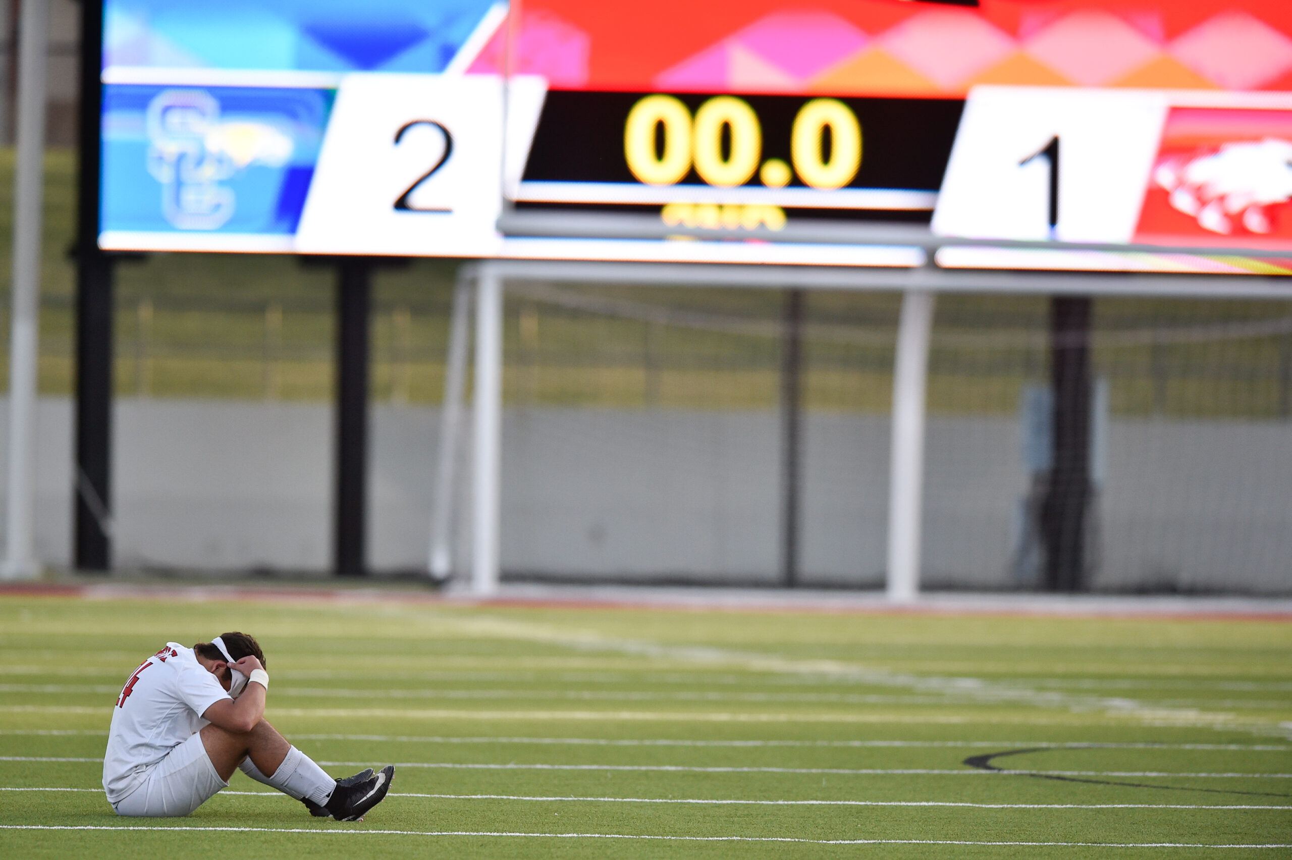 Argyle's Tyler DeBruin (24) puts his head down after his team loses to San Elizario 1-2 at Northwest I.S.D. Stadium, Friday, April 12, 2019, in Justin, Texas.