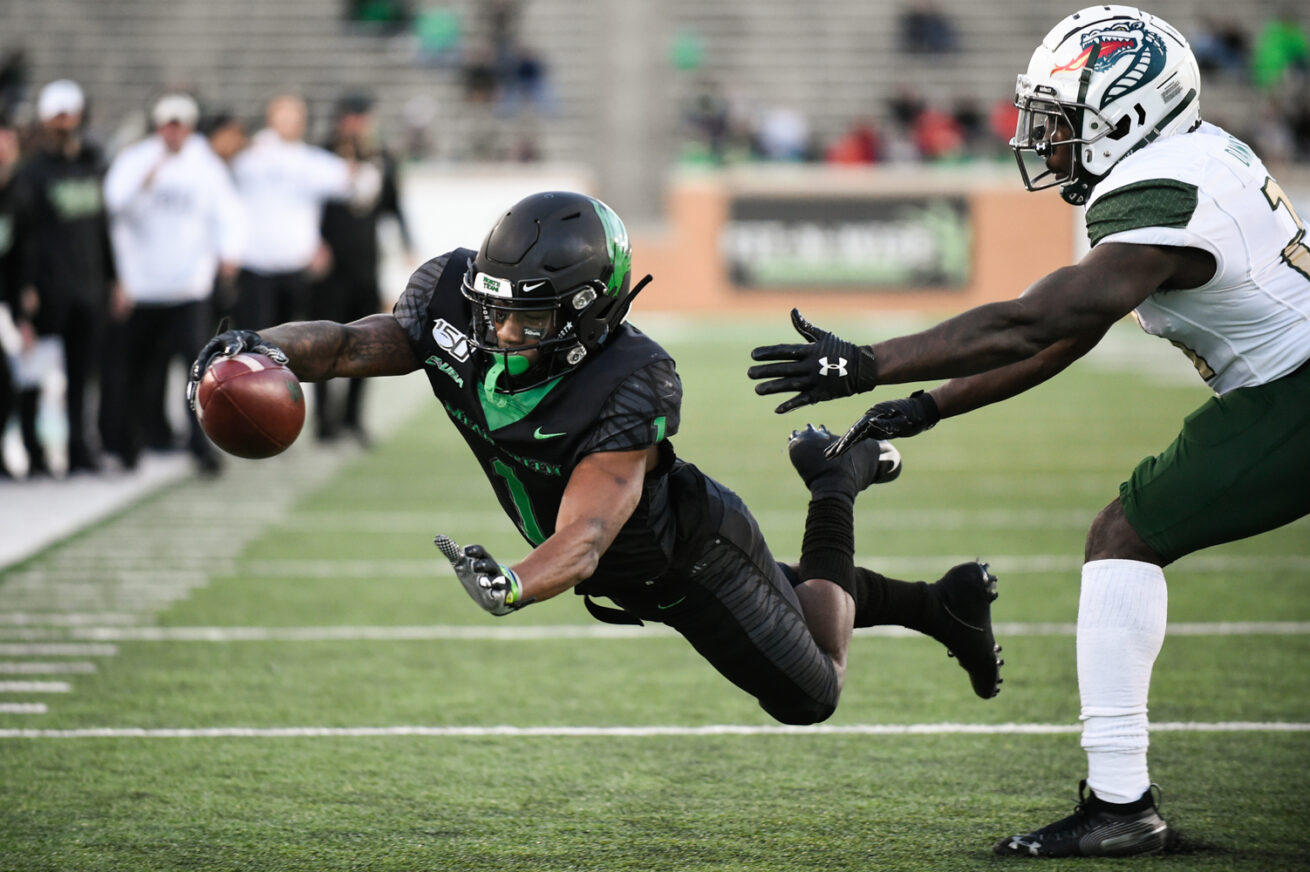 North Texas wide receiver Jaelon Darden (1) lunges for the end zone and scores a touchdown against Alabama-Birmingham at Apogee Stadium, Saturday, November 30, 2019, in Denton, Texas.