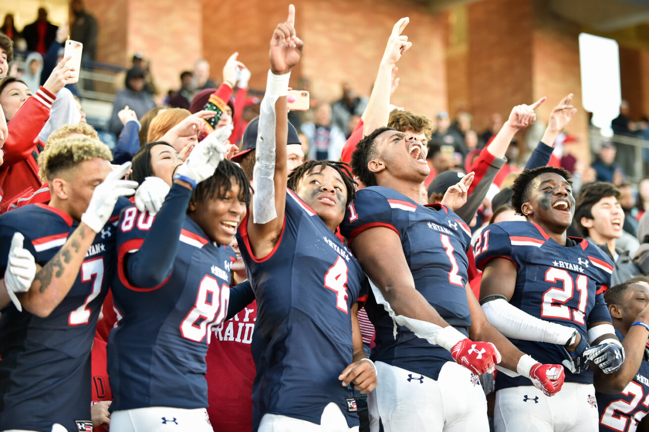 The Ryan High School football team celebrates after they defeat Lone Star at Allen's Eagle Stadium, Saturday, December 14, 2019, in Allen, Texas.