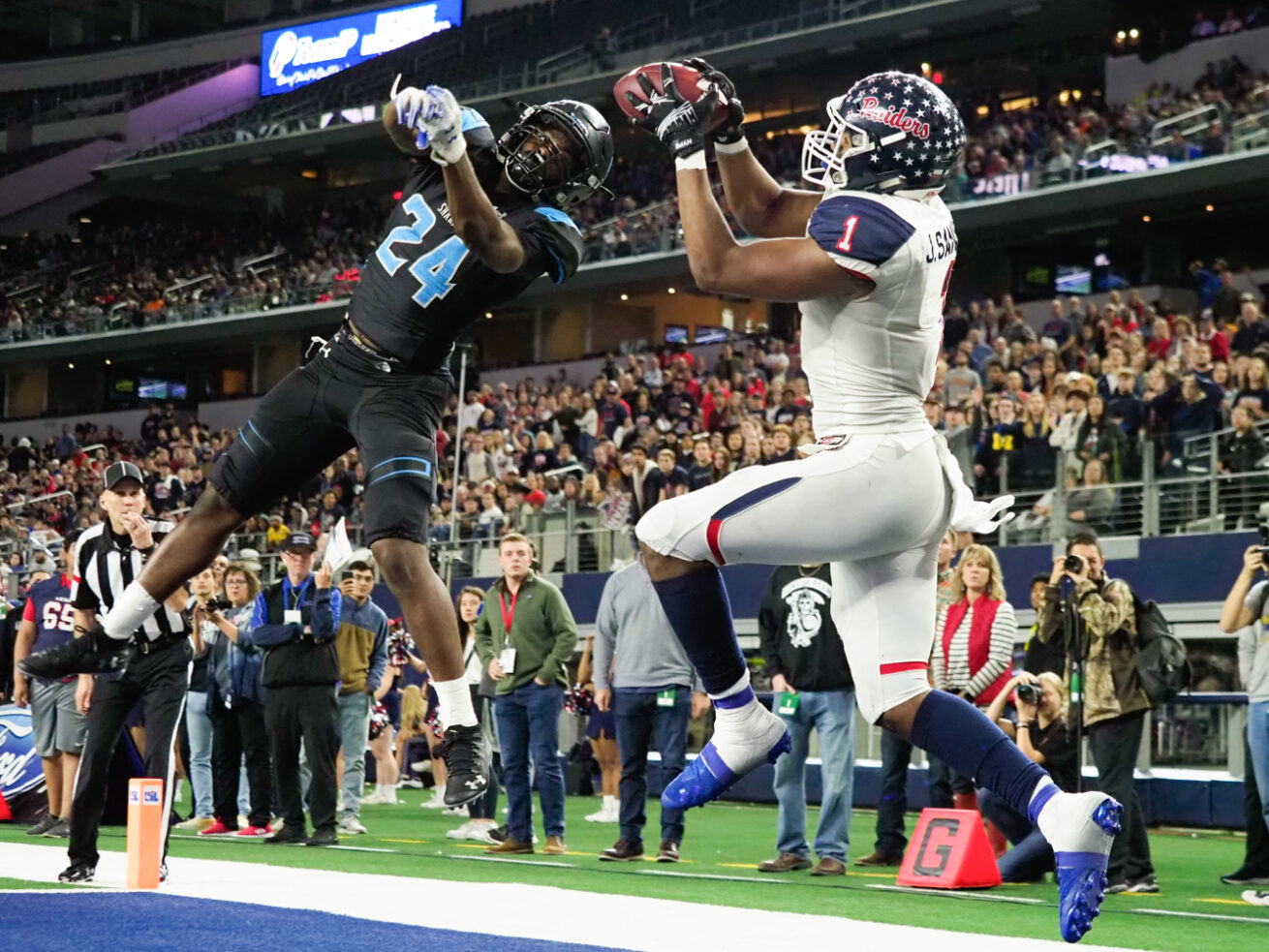 Ryan wide receiver Ja'Tavion Sanders (1) catches a pass for a touchdown, while being defended by Shadow Creek defensive back Chanceller Byers (24) at AT&T Stadium, Friday, December 20, 2019, in Arlington, Texas.
