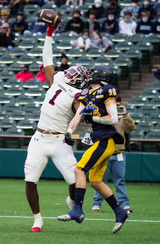 Ryan's Ja'Tavion Sanders (1) catches a pass and scores a touchdown against Highland Park at Globe Life Park, Friday, Jan. 1, 2021, in Arlington, Texas.
