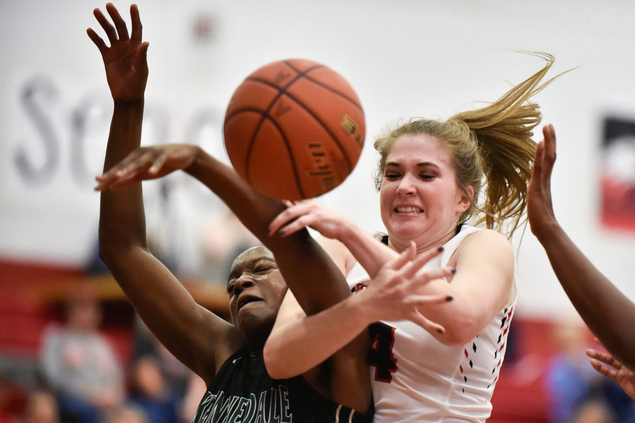 Argyle junior forward Sophie Betzhold (14) and Kennedale senior forward Lucy Benson (14) fight for a rebound at Argyle High School