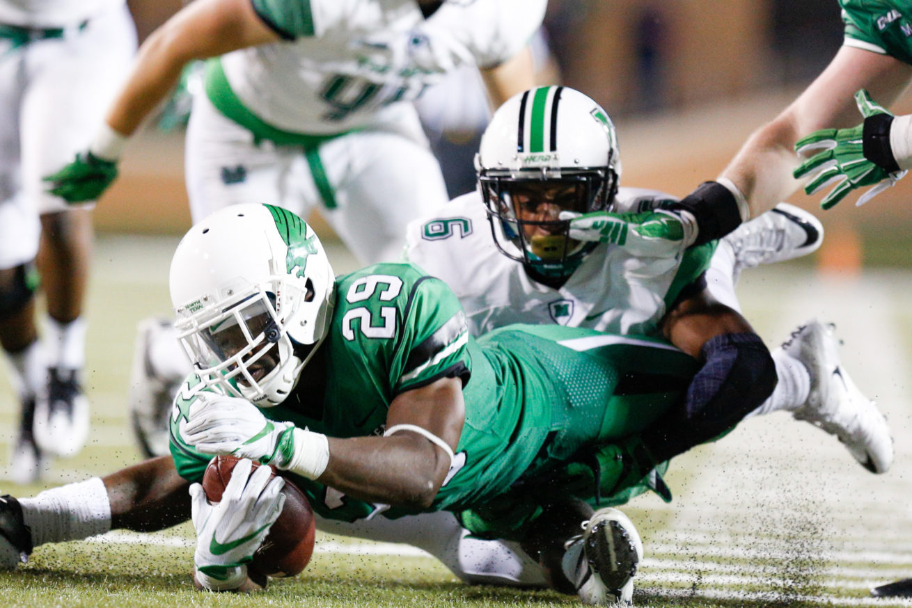 North Texas junior running back Willy Ivery (29) dives for extra yards against the Marshall defense at Apogee Stadium