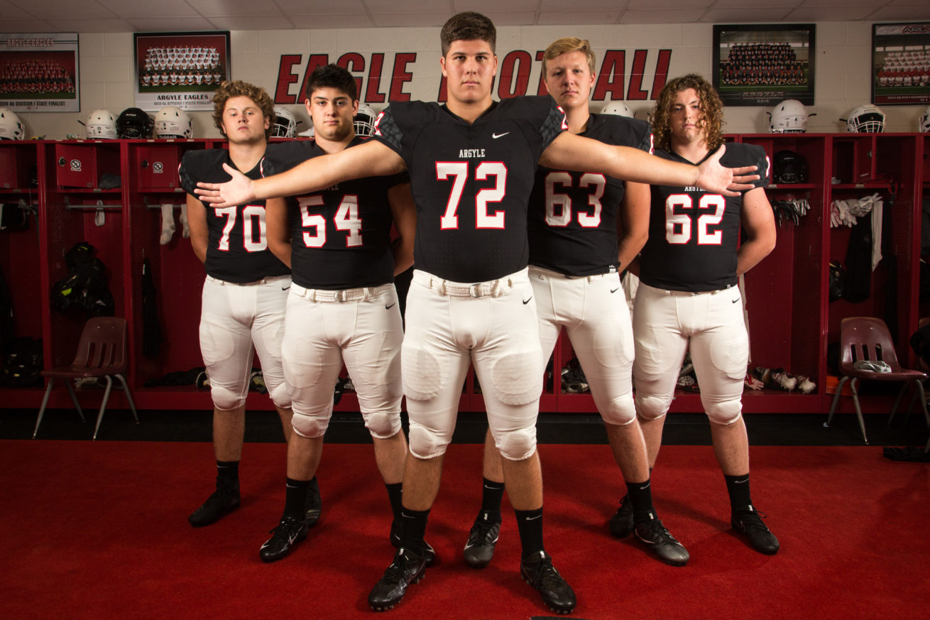 From left to right, Argyle's offensive line of Garrett Thomas, Brandon Michels, Preston Wilson, Connor Homeyer and Rylan Shobe pose for a portrait at Argyle High School.